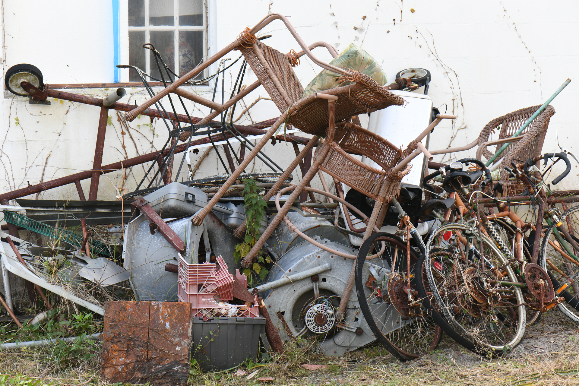 Junk Piled Up Next To The House That Needs Removal